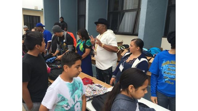 E-40 donates backpacks, school supplies to Vallejo school