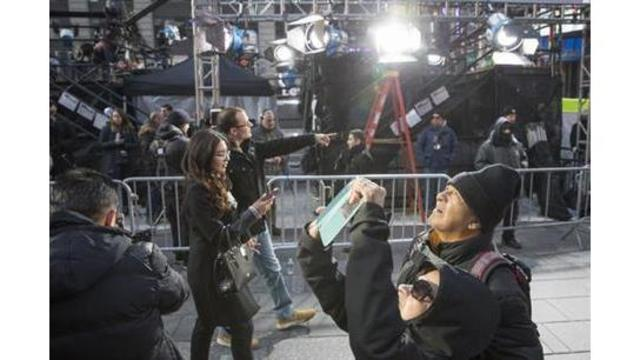 Hours early, New Year's revelers fill Times Square