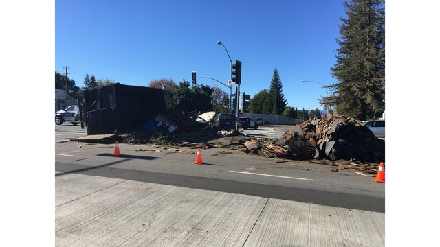 Big rig collides with cars, spills load in San Jose