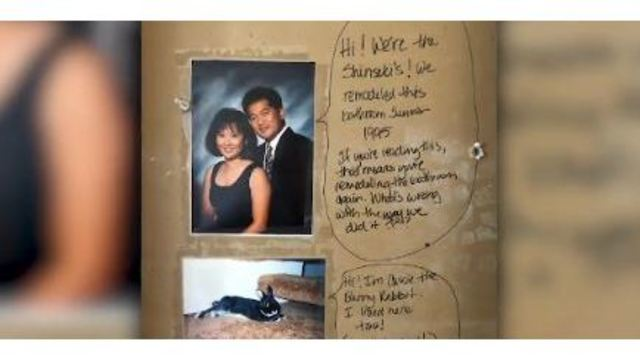 Couple finds hidden message in bathroom wall while remodeling